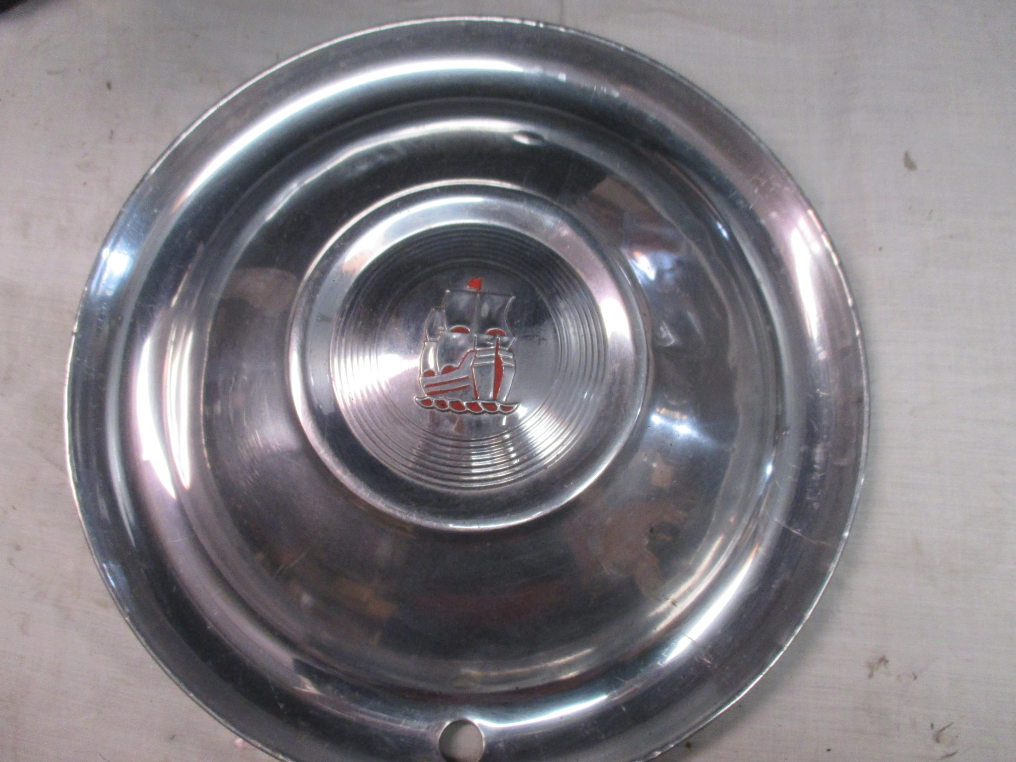 "'51-'52 PLYMOUTH,15"", USED HUBCAP, RIBBED, DOMED CENTER, SAILING SHIP LOGO,"